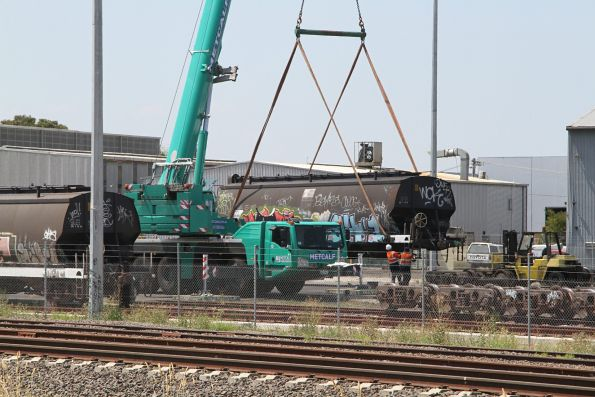 Mobile crane lifting a WGSY grain wagon