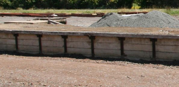 Concrete and steel face with timber capping, goods platform at Terang