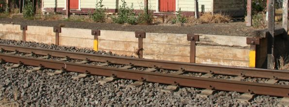 Cut back concrete and steel platform face at Westmere