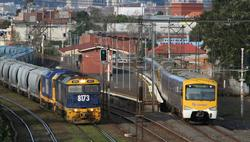 8173 and 8160 on a grain train chase a down Sydenham service at West Footscray