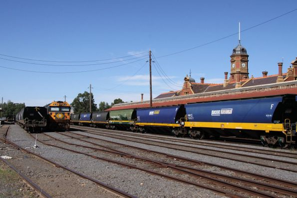 Many rakes of stabled grain wagons in the yard at Maryborough