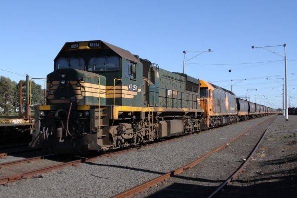 XR554 and BL32 stabled beside the mainline at North Geelong Yard with a broad gauge grain train