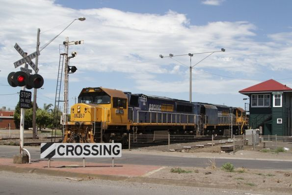 XR557 and XR555 depart North Geelong Yard with an empty grain train