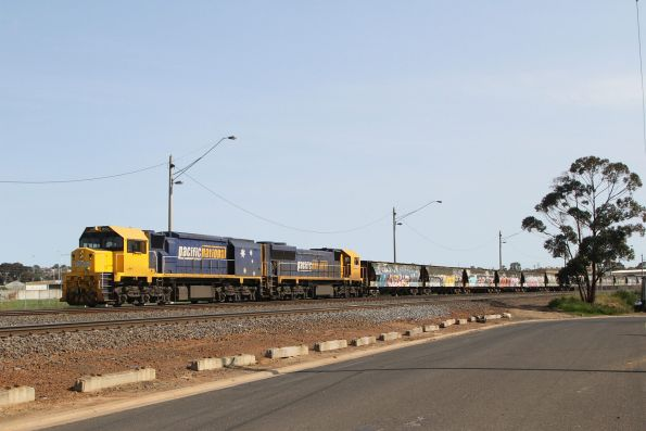 XR555 and XR550 on a broad gauge train waiting at North Geelong C for their turn around the grain loop
