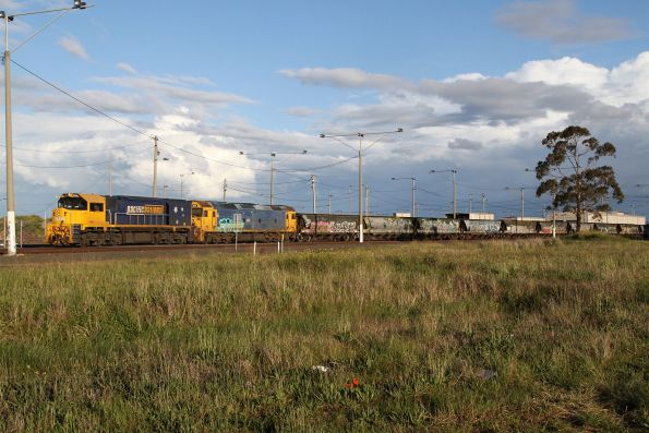 XR555 and G527 stabled at North Geelong Yard with a broad gauge grain