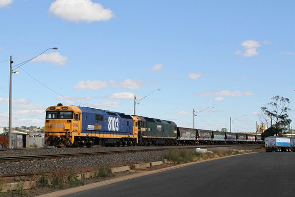 8103 and G523 arrive at North Geelong C with a standard gauge grain