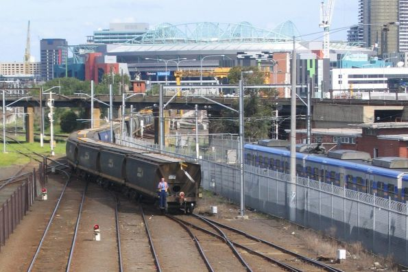 Second person guiding the grain wagons back into Melbourne Yard arrivals roads