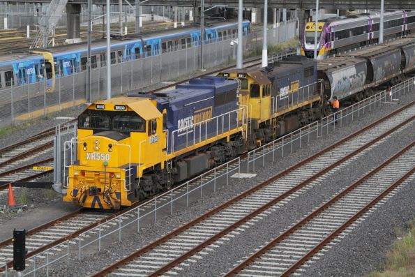 Second person detaches the grain wagons from XR551 and X41