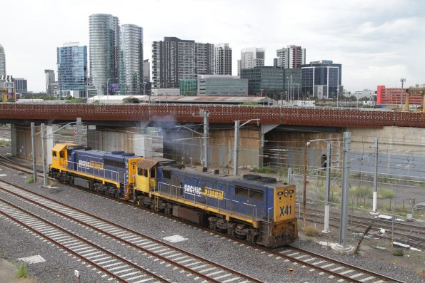 XR551 and X41 at North Melbourne shunt back around their train