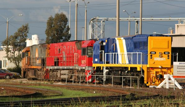 XRB561, Ghan liveried NR75 and another NR class outside the PN provisioning centre