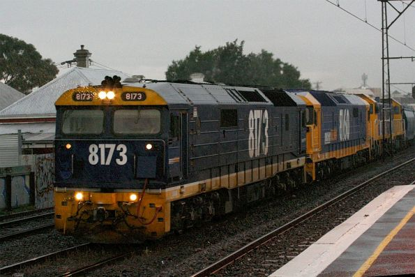 8173, 8160 and two T class run through the rain at Middle Footscray