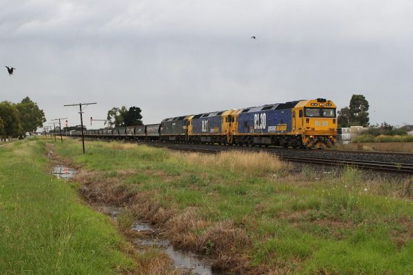 BL30, BL27 and G523 leads an empty grain consist through Albion, headed from NSW to western Victoria