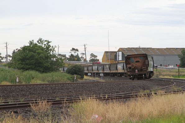 Tail end of an empty grain train at Albion, headed from NSW to western Victoria