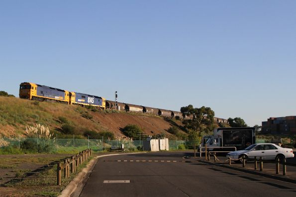 BL32 and 8145 leads a northbound standard gauge grain from western Victoria over the Tottenham Triangle towards southern NSW