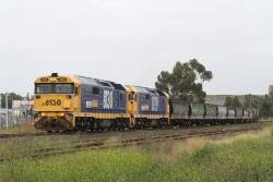 8130 and 8119 lead 7KQ7 northbound grain through Albion from Western Victoria