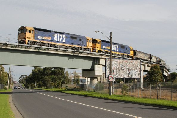 8172 and 8176 on a standard gauge grain head south over the Tottenham Triangle bound for Western Victoria