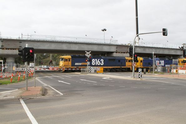 8163, BL30, 8231, 8134 and BL31 lead 7KG6 up grain through the temporary Werribee Street level crossing in Werribee