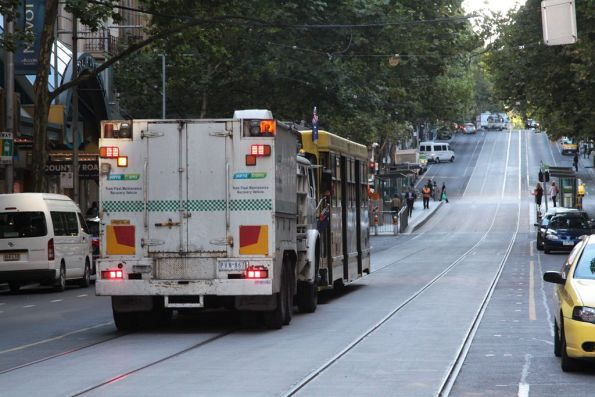 R10 continues pushing the tram east along Collins Street