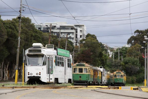 Z1.65 sits alone, SW6.908 leads one row of rotting trams, while SW6.855 leads the other