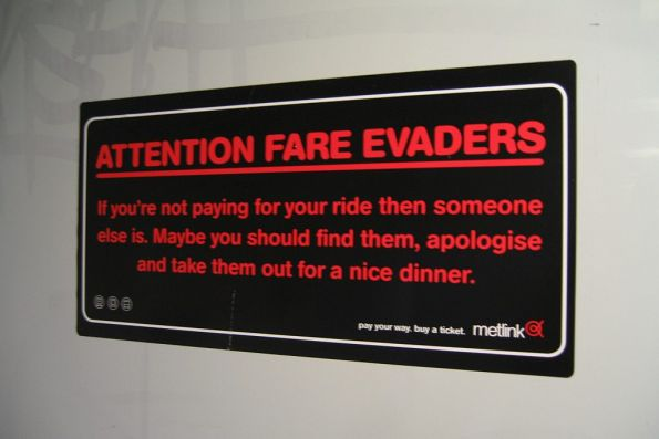 'Attention Fare Evaders - maybe you should take them out for dinner' campaign poster onboard a train