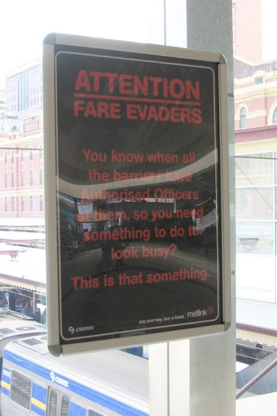 'Attention Fare Evaders - so you need something to look busy?' campaign poster at Flinders Street Station