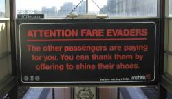 Metlink fare evader campaign advert at Flinders Street platform 2/3