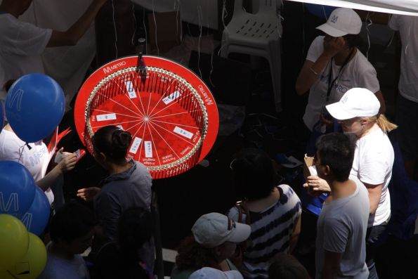 Spin the wheel and win a gift: Metro Trains Melbourne stall at Melbourne's Chinese New Year celebrations