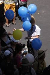 Authorised Officer handing out Metro Trains Melbourne branded helium balloons