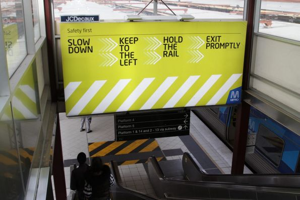 Escalator safety billboard at Flinders Street Station