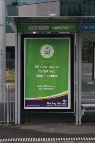 Poster for the Liberal Government's 'Moving Victoria' campaign, featuring the E class trams