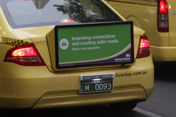 Poster for the Liberal Government's 'Moving Victoria' campaign on the back of a taxi