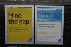 'Mind the gap' and 'Penalties apply for unauthorised parking' posters at South Morang station