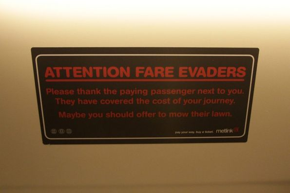2005-era Metlink 'Attention Fare Evaders' campaign stickers still in place onboard a Siemens train
