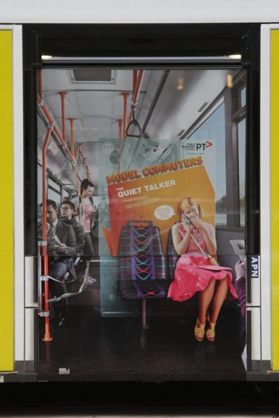 PTV 'Model Commuters' poster on a tram - 'The Quiet Talker'