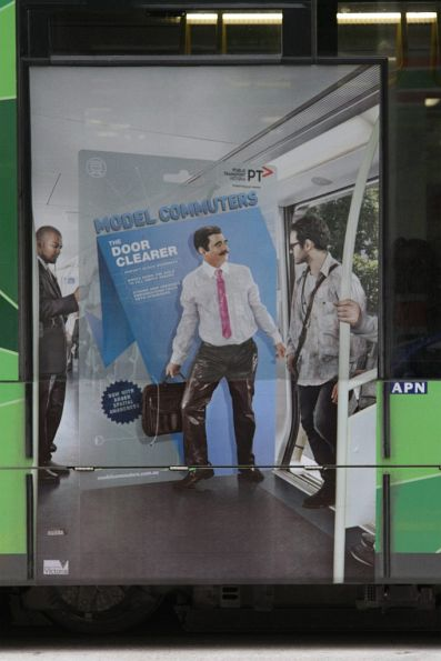 PTV 'Model Commuters' poster on a tram - 'The Door Clearer'