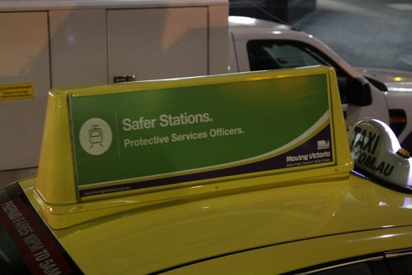 'Safer Stations. Protective Services Officers' propaganda atop a Melbourne taxi