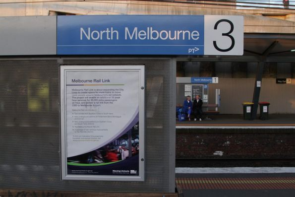 Poster advertising the 'Melbourne Rail Link' project at North Melbourne station