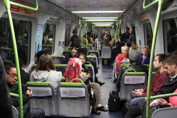 Abundance of 'Moving Victoria' propaganda onboard this Alstom Comeng train