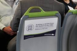 'Moving Victoria' propaganda stickers on the back of train seats, spruiking the Melbourne Rail Link project