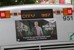 Transdev / PTV branded fare evasion advertisement on the rear of a bus
