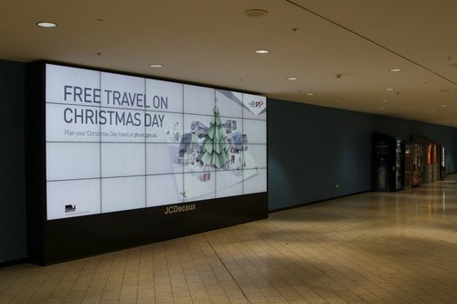 PTV advertisement for free travel on Christmas Day at Melbourne Central station