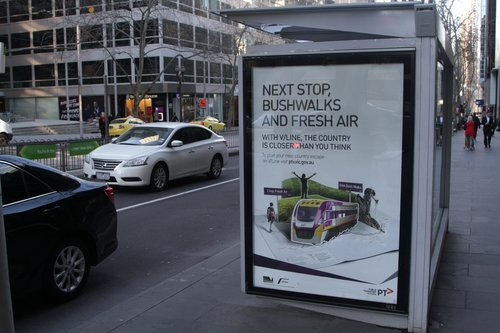 'Next stop, bushwalks and fresh air' promotion for V/Line, at a tram stop on William Street
