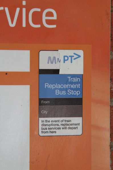 'PTV' logo replaces the 'Metro' brand on the *image* of a train replacement bus stop poster at a station