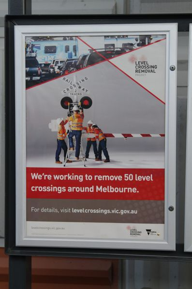 Level Crossing Removal Project poster at a suburban station