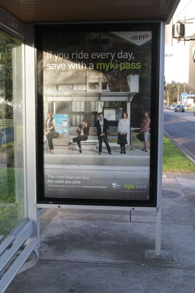 'If you ride every day, save with a myki pass' poster at a tram stop