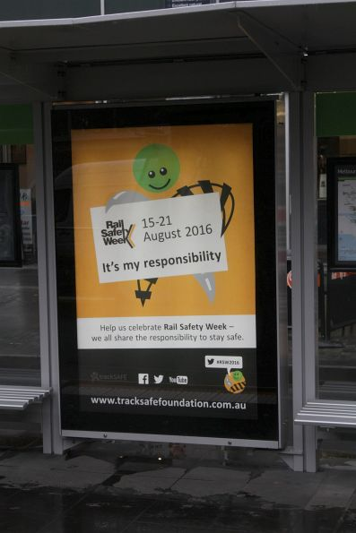 'Rail Safety Week' poster at a Melbourne CBD tram stop