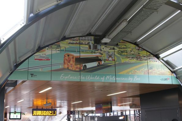 'Explore the world of Melbourne by bus' poster at Footscray station