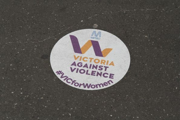 'Victoria Against Violence' sticker on a railway station platform