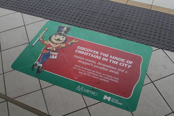 'Discover Christmas in the city' stickers on the ground at Flinders Street Station