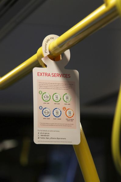 PTV hang tag onboard a bus, promoting extra tram, train and bus services for New Years Eve